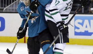 San Jose Sharks' Justin Braun (61) collides with Dallas Stars' Rich Peverley (17) during the second period of an NHL hockey game on Wednesday, Feb. 5, 2014, in San Jose, Calif. (AP Photo/Marcio Jose Sanchez)