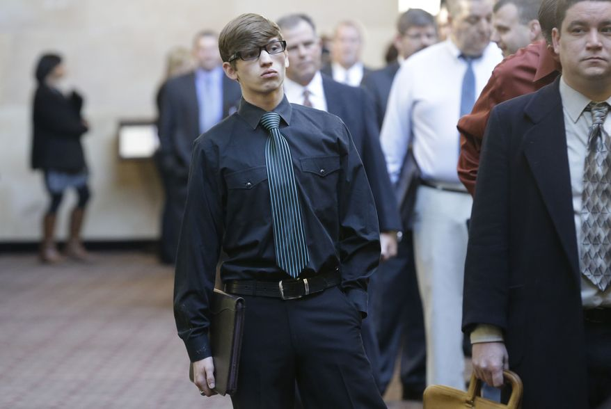 ** FILE ** In this Wednesday, Jan. 22, 2014, photo, Austin Moore, 18, lines up with other job seekers during a career fair at a hotel in Dallas. (AP Photo/LM Otero)