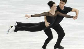 Scott and Tessa Moir of Canada practice during a the Ice Dance training session at the Iceberg Skating Palace ahead of the 2014 Winter Olympics, Wednesday, Feb. 5, 2014, in Sochi, Russia. (AP Photo/Bernat Armangue)