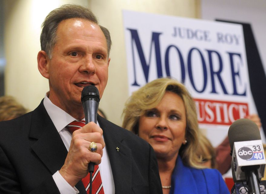 ** FILE ** In a Tuesday, Nov. 6, 2012, file photo, Roy Moore, candidate for Alabama Supreme Court chief justice, speaks to the audience as wife Kayla looks on at his election party in Montgomery, Ala., on election night. Alabama's chief justice Moore is spearheading an effort for a U.S. constitutional amendment that would define the institution of marriage as a union between one man and one woman. (AP Photo/David Bundy, File)