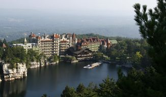 FILE - A view of the Mohonk Mountain House in New Paltz, N.Y., in this Aug. 28, 2007 file photo. The Catskill mountain resort is closing for a week after a virus sickened hundreds of guests and employees. The Mohonk Mountain House in New Paltz will close at 1 p.m. Friday Feb. 7, 2014. It expects to reopen on Feb. 14.  (AP Photo/Mike Groll, File)
