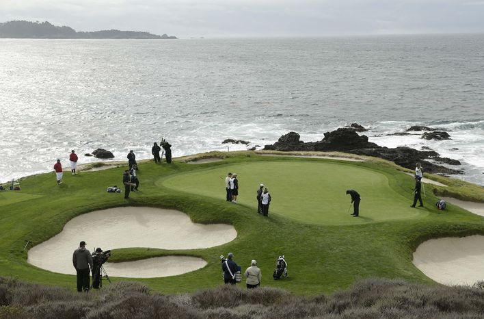 Phil Mickelson putts on the seventh green of the Pebble Beach Golf Links during the second round of the AT&T Pebble Beach Pro-Am golf tournament on Friday, Feb. 7, 2014, in Pebble Beach, Calif. (AP Photo/Eric Risberg)