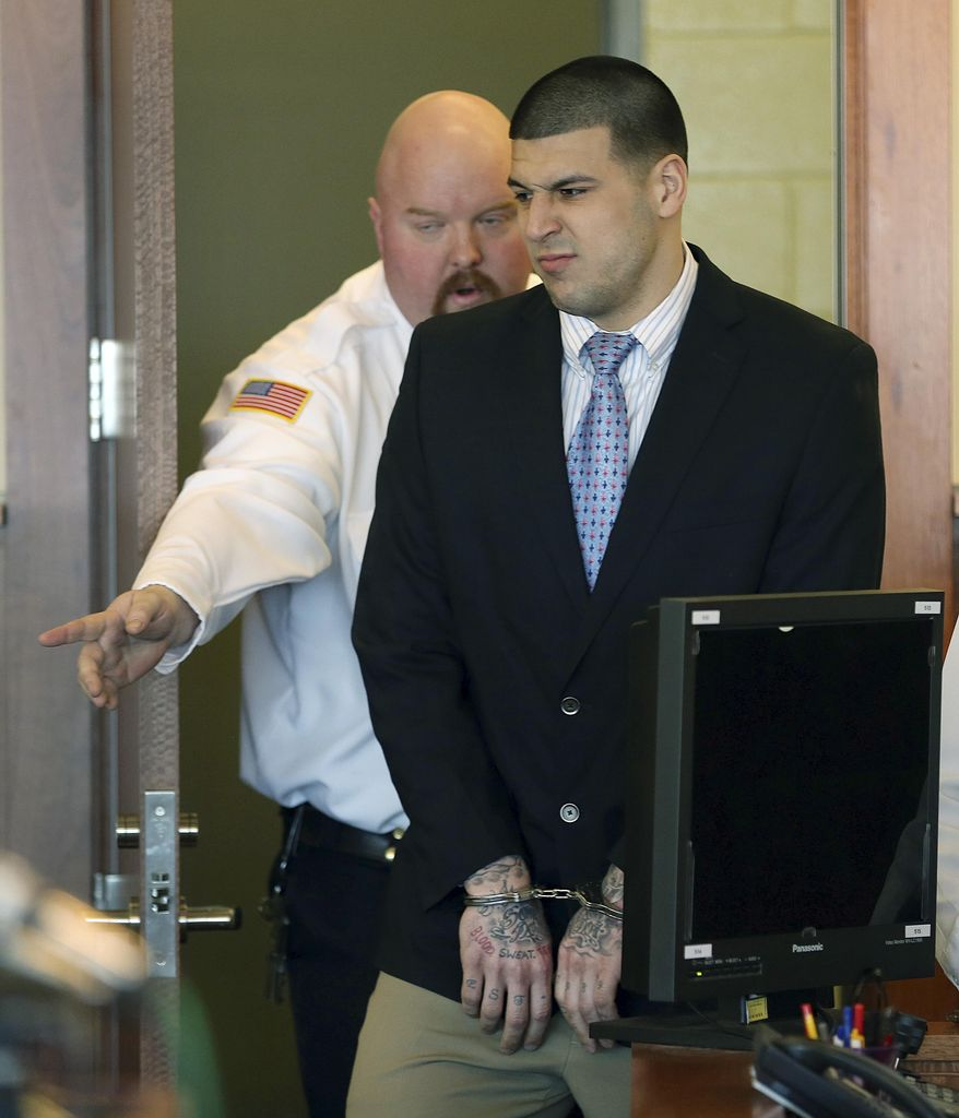 Former New England Patriots football player Aaron Hernandez enters the courtroom for a hearing at Bristol Superior Court on Friday, Feb. 7, 2014, in Fall River, Mass. At the hearing, the judge rejected a request by prosecutors for Hernandez's jailhouse phone recordings, then ordered them to turn over to the defense copies of calls they acknowledged already having. The ex-NFL player has pleaded not guilty to murder in the killing of Odin Lloyd, a 27-year-old Boston man who was dating the sister of Hernandez's fiancee. Lloyd, a semi-professional football player was found dead June 17 near Hernandez's North Attleborough home. (AP Photo/The Boston Globe, Jonathan Wiggs, Pool)