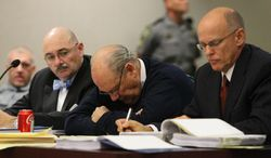 Former Tampa Police captain Curtis Reeves, Jr., center, sits beside his defense attorneys Richard Escobar, right, and Dino Michaels as they listen to his taped interview by detectives during his bond reduction hearing before Circuit Judge Pat Siracusa at the Robert D. Sumner Judicial Center in Dade City Friday, Feb. 7, 2014. Reeves is suspected of fatally shooting Chad Oulson, 43, and wounding his wife, Nicole, 33, during an argument Jan. 13 over texting at the Cobb Grove 16 theater in Wesley Chapel, Fla.  (AP Photo/Pool Tampa Bay Times, Brendan Fitterer, Pool)