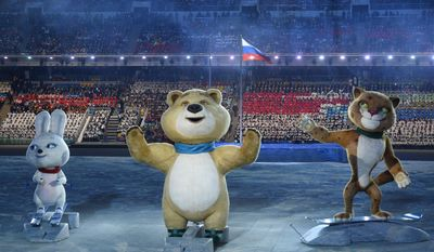 The 2014 Winter Olympic games official mascots, the Leopard, the Polar Bear, and the Hare, perform during the opening ceremony of the 2014 Winter Olympics in Sochi, Russia, Friday, Feb. 7, 2014. (AP Photo/Lionel Bonaventure, Pool)