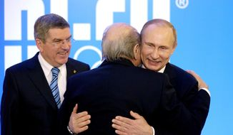 Russian President Vladimir Putin, right, embraces Federal International Football Association President Sepp Blatter as International Olympic Committee President Thomas Bach, left, looks on at an event welcoming IOC members ahead of the upcoming 2014 Winter Olympics at the Rus Hotel, Tuesday, Feb. 4, 2014, in Sochi, Russia. (AP Photo/David Goldman, Pool)