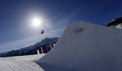 Britain's James Woods takes a jump during ski slopestyle training at the Rosa Khutor Extreme Park ahead of the 2014 Winter Olympics, Friday, Feb. 7, 2014, in Krasnaya Polyana, Russia. (AP Photo/Sergei Grits)
