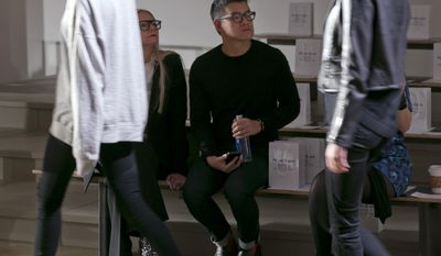 Designer Peter Som watches the rehearsal before his Fall 2014 collection is modeled during Fashion Week in New York,  Friday, Feb. 7, 2014. (AP Photo/Richard Drew)