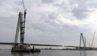 FILE - In this May 2, 2013 file photo, a four-lane, cable-stayed bridge named after St. Louis Cardinals great Stan Musial is seen from St. Louis under construction spanning across the Mississippi River from Missouri to Illinois. The $700 million project that took a few years, and a few squabbles, to complete is set to open for motorists on Sunday, Feb. 9, 2014. (AP Photo/Jeff Roberson, File)