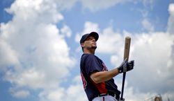 FILE - In this Oct. 2, 2013 file photo, Atlanta Braves' Chris Johnson waits to take baseball batting practice in Atlanta. Johnson is taking the same approach to the 2014 season he used one year ago, when he was fighting for a starting job. (AP Photo/David Goldman, file)
