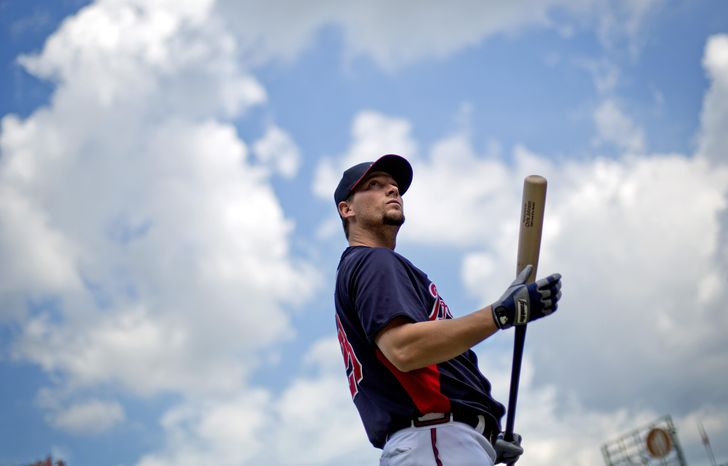 FILE - In this Oct. 2, 2013 file photo, Atlanta Braves' Chris Johnson waits to take baseball batting practice in Atlanta. Johnson is taking the same approach to the 2014 season he used one yea