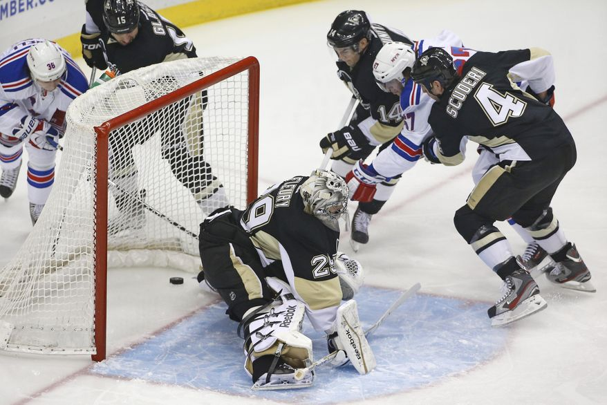 New York Rangers' Benoit Pouliot (67) get the puck past Pittsburgh Penguins goalie Marc-Andre Fleury (29) for a goal while being checked by Penguins' Rob Scuderi (4) and Chris Kunitz (14) during the first period of an NHL hockey game in Pittsburgh, Friday, Feb. 7, 2014. (AP Photo/Gene J. Puskar)