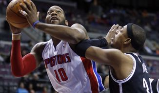 Detroit Pistons center Greg Monroe (10) tries to go to the basket against Brooklyn Nets forward Paul Pierce, right, during the first half of an NBA basketball game on Friday, Feb. 7, 2014, in Auburn Hills, Mich. (AP Photo/Duane Burleson)