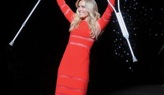 American World Cup alpine ski racer Lindsey Vonn walks the runway with crutches at the 2014 Red Dress Collection on Thursday, Feb 6, 2014 in New York. (Photo by Brad Barket/Invision/AP)
