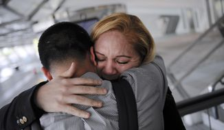 In this Wednesday, Dec. 25, 2013 photo, Melba Soza embraces her son Jose Antonio as he arrives at the airport in Bilbao, Spain from the United States for a five-day visit with his mother. For the past three years, Jose has been on a mission: To bring his mother back to the U.S. His work has taken him to Congress, gotten him meetings with the likes of Donald Trump and Mark Zuckerberg, landed him on television. Along the way, he has grown into a steady force in the national immigration debate, a young but powerful voice for his family and the many others hoping to one day reunite. (AP Photo/Alvaro Barrientos)