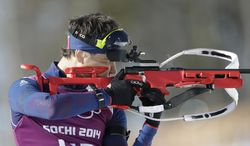 Norway's Ole Einar Bjorndalen shoots during a biathlon training session at the 2014 Winter Olympics, Friday, Feb. 7, 2014, in Krasnaya Polyana, Russia. (AP Photo/Lee Jin-man)