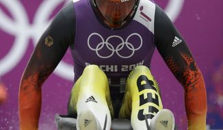 Felix Loch of Germany starts a run during a training session for the men's singles luge at the 2014 Winter Olympics Friday, Feb. 7, 2014, in Krasnaya Polyana, Russia. (AP Photo/Dita Alangkara)