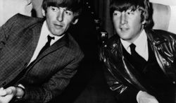 """FILE - In this May 25, 1964 file photo, the Beatles' George Harrison, left, and John Lennon, are seen aboard an airplane in Los Angeles, before leaving for London. In the fall of 1963, Harrison spent two weeks visiting his sister Louise Harrison in Benton, Ill., making him the first Beatle to come to the United States. That vacation was five months before the group's landmark live appearance on """"The Ed Sullivan Show"""" launched the British invasion. While in Illinois, Harrison and the Beatles were virtually unknown in America, explaining why he enjoyed anonymity in 7,000-resident Benton. (AP Photo/File)"""