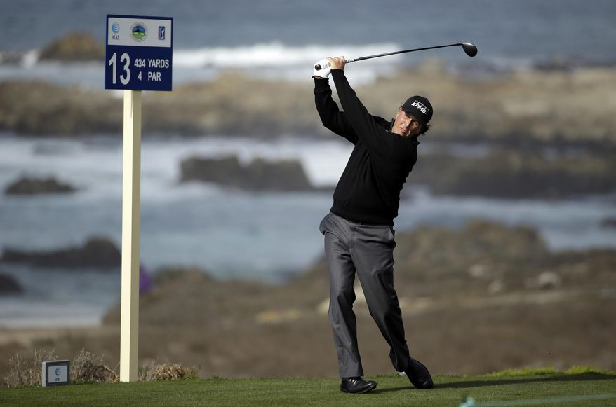 Phil Mickelson follows his drive from the 13th tee of the Shore Course at Monterey Peninsula during the first round of the AT&T Pebble Beach Pro-Am golf tournament Thursday, Feb. 6, 2014, in Pebble Beach, Calif. (AP Photo/Eric Risberg)