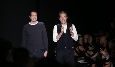 Designers Marcus Wainwright, left, and David Neville acknowledge the audience after the Rag & Bone Fall 2014 collection show during Fashion Week in New York, Friday, Feb. 7, 2014. (AP Photo/Jason DeCrow)