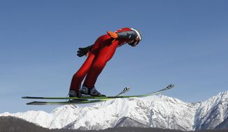 Poland's Kamil Stoch makes an attempt during the men's normal hill ski jumping training at the 2014 Winter Olympics, Friday, Feb. 7, 2014, in Krasnaya Polyana, Russia. (AP Photo/Matthias Schrader)