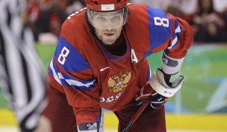 Russia's Alexander Ovechkin waits for faceoff in the third period of a men's preliminary round ice hockey game against the Czech Republic at the Vancouver 2010 Olympics in Vancouver, British Columbia, Sunday, Feb. 21, 2010. (AP Photo/Chris O'Meara)