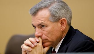 **FILE** Rep. David Schweikert, Arizona Republican, listens Dec. 6, 2013, in Apache Junction, Ariz., to testimony during a House Oversight and Government Reform Committee Congressional Field Hearing on the Affordable Care Act's impact on Americans. (Associated Press)