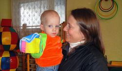 FILE - In this 2009 photo provided by the family, Renee Thomas holds Nikolai at an orphanage in Kursk, Russia. On Thursday, Feb. 6, 2014, Thomas went on television in Russia with an emotional appeal for an exception to be made to Russia's year-old ban on adoptions by Americans. She and her husband adopted a boy from Russia in 2008 and refuse to give up long-standing efforts to also adopt Nikolai, their son's biological brother. (AP Photo)