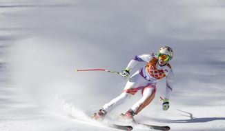 Liechtenstein's Tina Weirather coles to a halt at the end of a women's downhill training run for the Sochi the 2014 Winter Olympics, Friday, Feb. 7, 2014, in Krasnaya Polyana, Russia. (AP Photo/Gero Breloer)
