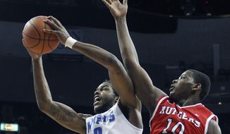 Memphis forward Shaq Goodwin (2) grabs a rebound against Rutgers forward Junior Etou (10) in the first half of an NCAA college basketball game, Tuesday, Feb. 4, 2014, in Memphis, Tenn. (AP Photo/Lance Murphey)