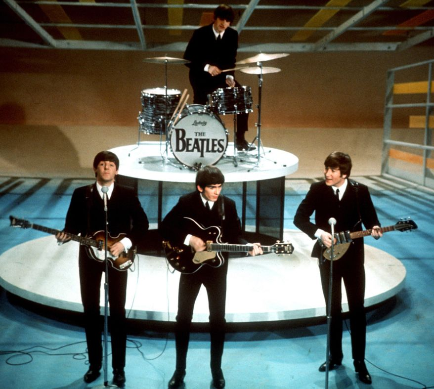 "FILE - In this Feb. 9, 1964, file photo, The Beatles, from left, Paul McCartney, George Harrison, Ringo Starr on drums, and John Lennon perform on the CBS ""Ed Sullivan Show"" in New York. The Beatles made their first appearance on ""The Ed Sullivan Show,"" America's must-see weekly variety show, on Sunday, Feb. 9, 1964, and officially kicked off Beatlemania. (AP Photo/File)"