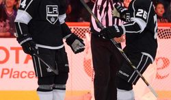 Los Angeles Kings defenseman Robyn Regehr, left, of Brazil, celebrates his game-winning goal with teammate defenseman Slava Voynov, of Russia, during the overtime period of an NHL hockey game against the Columbus Blue Jackets, Thursday, Feb. 6, 2014, in Los Angeles. (AP Photo/Mark J. Terrill)