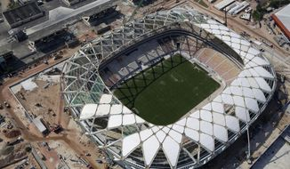 FILE - This Dec. 10, 2013 file photo shows an aerial view of the Arena da Amazonia stadium in Manaus, Brazil. A worker was injured in an accident outside this World Cup stadium, local organizers said Friday, Feb. 7, 2014. Organizers in charge of the stadium's construction said the worker was hurt while dismantling a crane that was used to install the roof. (AP Photo/Renata Brito, File)