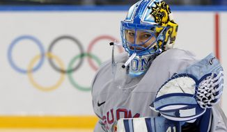 Goalkeeper of Finland's women's ice hockey team Noora Raty catches a puck during a practice session ahead of the 2014 Winter Olympics, Thursday, Feb. 6, 2014, in Sochi, Russia. (AP Photo/Petr David Josek)