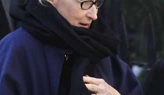 Actress Meryl Streep arrives at the Church of St. Ignatius Loyola for the private funeral of actor Philip Seymour Hoffman Friday, Feb. 7, 2014, in New York. Hoffman, 46, was found dead Sunday of an apparent heroin overdose. (AP Photo/Jason DeCrow)