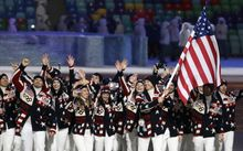 Todd Lodwick of the United States carries the national flag as he leads the team during the opening ceremony of the 2014 Winter Olympics in Sochi, Russia, Friday, Feb. 7, 2014. (AP Photo/Mark Humphrey)