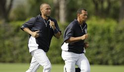 FILE - In this March 11, 2012 file photo, New York Yankees shortstop Derek Jeter and third baseman Alex Rodriguez run wind sprints before their spring training baseball game against the Philadelphia Phillies at Steinbrenner Field in Tampa, Fla. Yankees captain Derek Jeter doesn't know whether suspended teammate Alex Rodriguez will join the team at spring training this month. Rodriguez was dealt the most severe punishment in the history of baseball's drug agreement when an arbitrator ruled last month the third baseman is suspended for the entire 2014 season for violations of the drug rules and the sport's labor contract. (AP Photo/Kathy Willens, File)