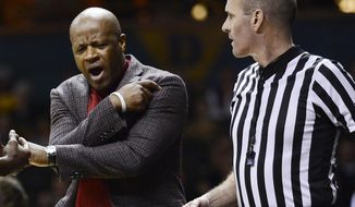Arkansas head coach Mike Anderson reacts after an official called a foul on one his players in the first half of an NCAA college basketball against Vanderbilt game Saturday, Feb. 8, 2014, in Nashville, Tenn. (AP Photo/Mark Zaleski)