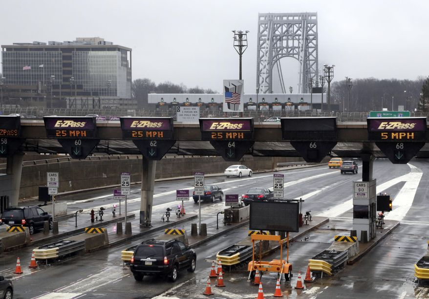 "FILE - In this Jan. 11, 2014, file photo, traffic passes through the toll booths at the George Washington Bridge, in Fort Lee, N.J.  On paper, David Wildstein's title at the Port Authority of New York and New Jersey was ""Director of Interstate Capital Projects."" But many who worked there knew his real job, a post created just for him in 2010, was to further Republican Gov. Chris Christie's agenda inside the agency.He led efforts to give New Jersey officials more sway over authority operations. Now, the man who was known as the administration's eyes and ears at the Port Authority may be the public's best chance of knowing the truth behind a plan last summer to purposely create days of traffic gridlock in Fort Lee, N.J., by choking off local access to the George Washington Bridge.(AP Photo/Richard Drew, File)"