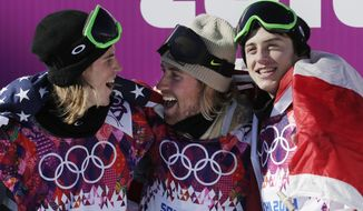 United States' Sage Kotsenburg, center, celebrates with  Norway's Staale Sandbech, left, and Canada's Mark McMorris after Kotsenburg won the men's  snowboard slopestyle final at the Rosa Khutor Extreme Park, at the 2014 Winter Olympics, Saturday, Feb. 8, 2014, in Krasnaya Polyana, Russia. Sandbech took the silver medal and McMorris took bronze. (AP Photo/Andy Wong)