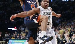 Virginia guard Malcolm Brogdon (15) is fouled by Georgia Tech guard Corey Heyward (30) as he goes for a basket in the second half of an NCAA college basketball game Saturday, Feb. 8, 2014, in Atlanta.  Virginia won 64-45. (AP Photo/John Bazemore)