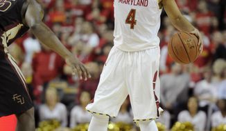 Maryland guard Seth Allen (4) dribbles the ball against Florida State guard Aaron Thomas, left, during the second half of an NCAA college basketball game on Saturday, Feb. 8, 2014, in College Park, Md. Maryland won 83-71. (AP Photo/Nick Wass)