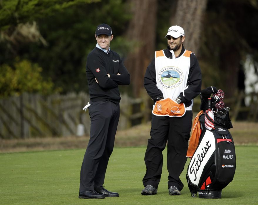 Jimmy Walker, left, waits to hit from the second fairway Saturday, Feb. 8, 2014, during the third round of the AT&T Pebble Beach Pro-Am golf tournament on the Monterey Peninsula Country Club Shore Course in Pebble Beach, Calif. (AP Photo/Ben Margot)