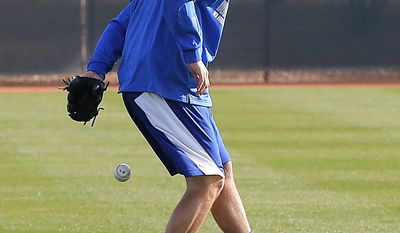 Los Angeles Dodgers pitcher Matt Magill tries to make a catch on the practice field after reporting to camp, Saturday, Feb. 8, 2014, in Glendale, Ariz. The Dodgers first spring training baseball practice begins Sunday. (AP Photo/Matt York)
