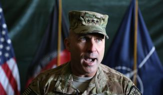 Lt. Gen. Joseph Anderson speaks during a change of command ceremony at the International Security Assistance Force (ISAF) Base in Kabul, Afghanistan, Saturday, Feb. 8, 2014. The incoming No. 2 American commander in Afghanistan, Lt. Gen. Anderson, said his immediate focus is on supporting Afghan elections - not on the possibility of U.S. troops remaining after the NATO-led combat mission ends. (AP Photo/Rahmat Gul)