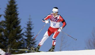 Norway's gold medal winner Marit Bjoergen skis during the women's cross-country 15k skiathlon at the 2014 Winter Olympics, Saturday, Feb. 8, 2014, in Krasnaya Polyana, Russia. (AP Photo/Lee Jin-man)