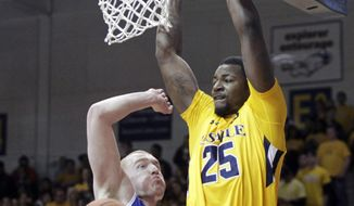 Saint Louis' John Manning, left, defends as La Salle's Jerrell Wright (25) scores in the first half of an NCAA college basketball game Saturday, Feb. 8, 2014, in Philadelphia. (AP Photo/H. Rumph Jr.)