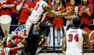 Missouri forward Tony Criswell (2) fouls Mississippi guard Ladarius White (10) during the first half of an NCAA college basketball game in Oxford, Miss., Saturday, Feb. 8, 2014. (AP Photo/Thomas Graning)
