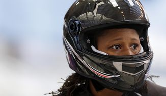 Lauryn Williams with the United States team, gets out of her sled after a training run for the two-man bobsled at the 2014 Winter Olympics, Thursday, Feb. 6, 2014, in Krasnaya Polyana, Russia. (AP Photo/Natacha Pisarenko)