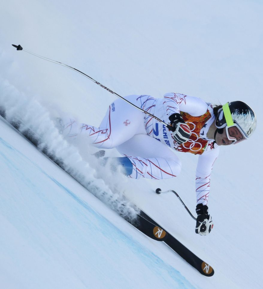 United States' Jacqueline Wiles speeds down the course after a women's downhill training run for the Sochi 2014 Winter Olympics, Saturday, Feb. 8, 2014, in Krasnaya Polyana, Russia. (AP Photo/Charles Krupa)